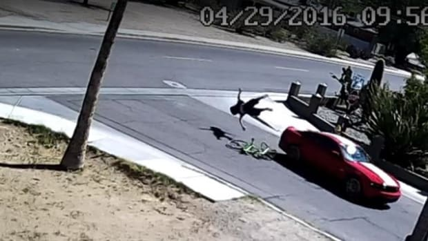 Woman Allegedly Slams Into Boyfriend With Car (Video) Promo Image