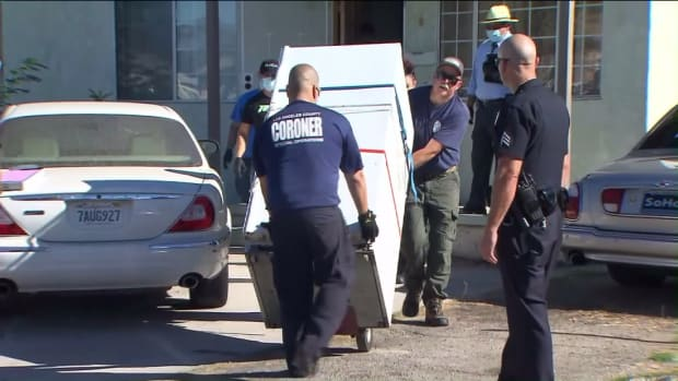Police Wheeling A Refrigerator With A Dead Body Out Of A Sun Valley Home.