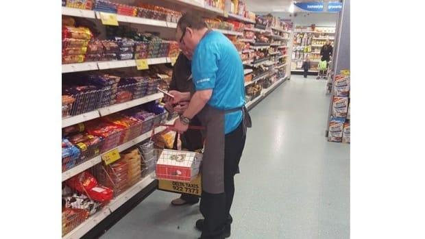 Photo Of Store Clerk Helping Elderly Man Goes Viral Promo Image