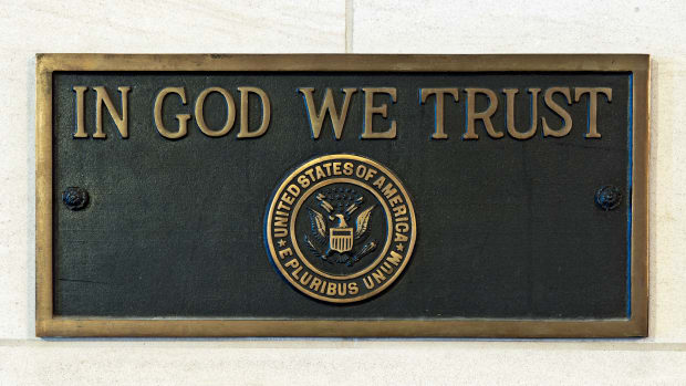 'In God We Trust' Plaque.