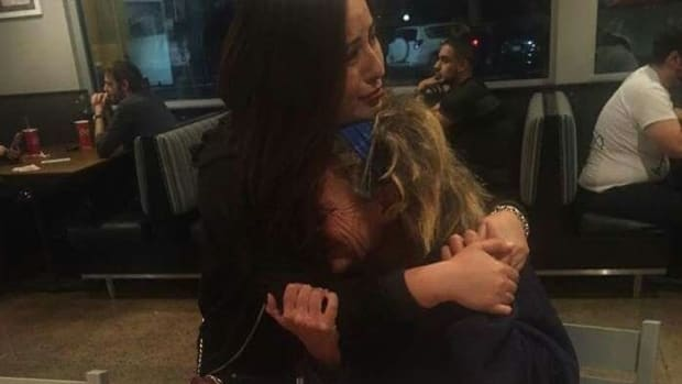Woman's Act Of Kindness Leads To Emotional Hug (Photo) Promo Image