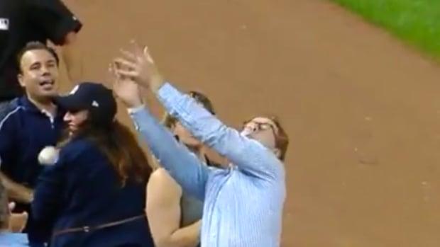 Yankees Fan Drops Balls
