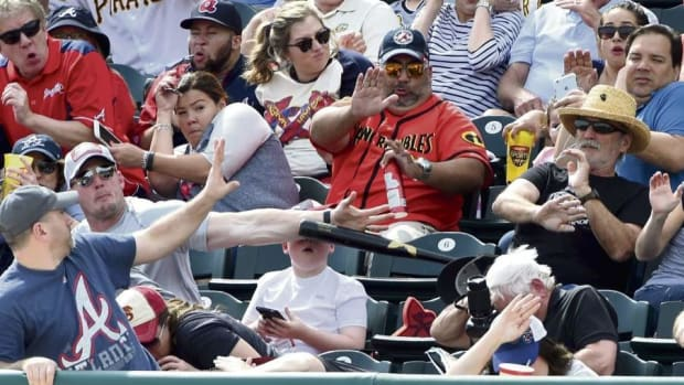 Man Saves Boy From Getting Hit By Flying Baseball Bat Promo Image