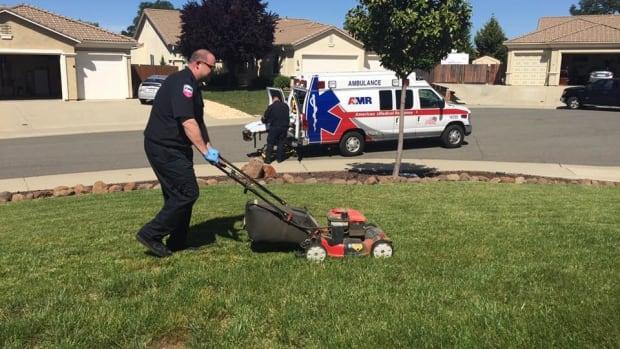 Man Faints, EMT Finishes Mowing His Lawn (Photo) Promo Image