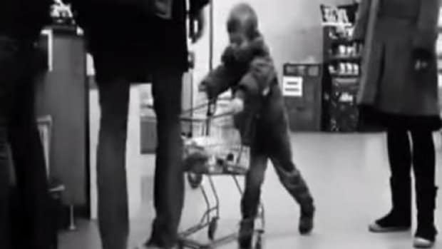 Man's Surprising Response When Young Boy Keeps Hitting His Leg With A Cart Goes Viral (Video) Promo Image