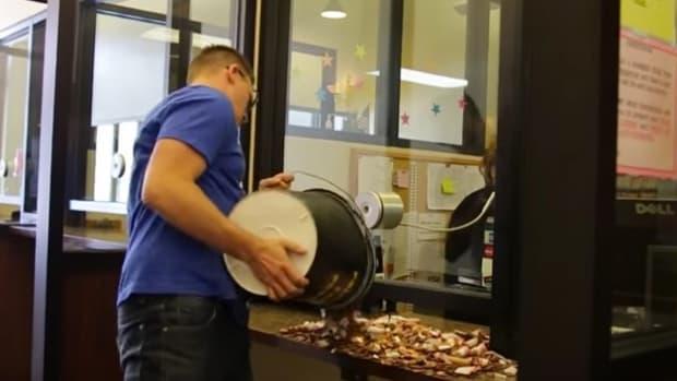 Man Pays Speeding Ticket In Pennies (Video) Promo Image