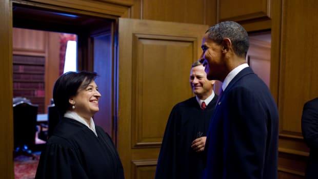 President Barack Obama with Justice Elena Kagan and Chief Justice John Roberts.