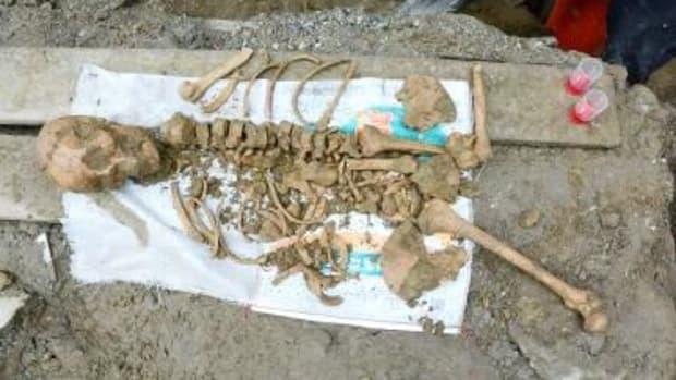 4,800-Year-Old Female Skeleton Cradling Baby Found Promo Image