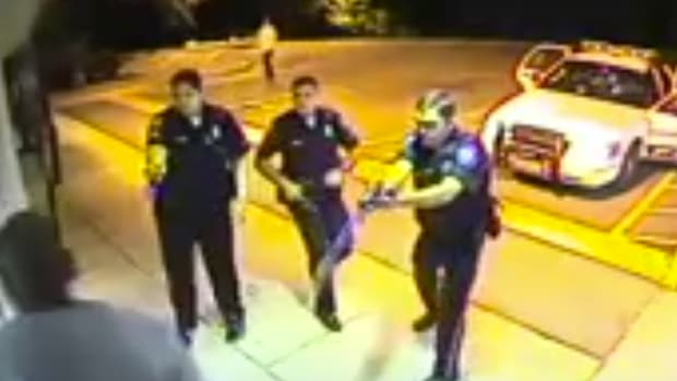 police using tasers on Linwood Lambert