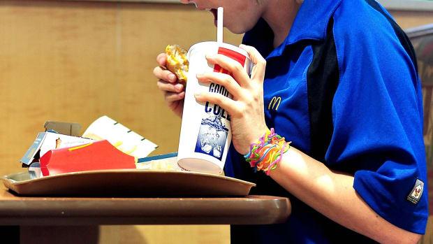 McDonalds employee eating