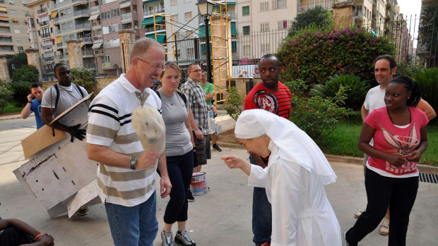 American volunteers meet with nuns from the Little Sisters of the Poor in Spain.