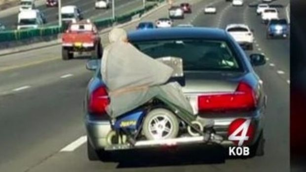 Photo Of Man Strapped To Back Of Car Goes Viral (Video) Promo Image