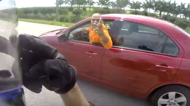 Motorcyclist And Driver In Wild Road Rage (Video) Promo Image