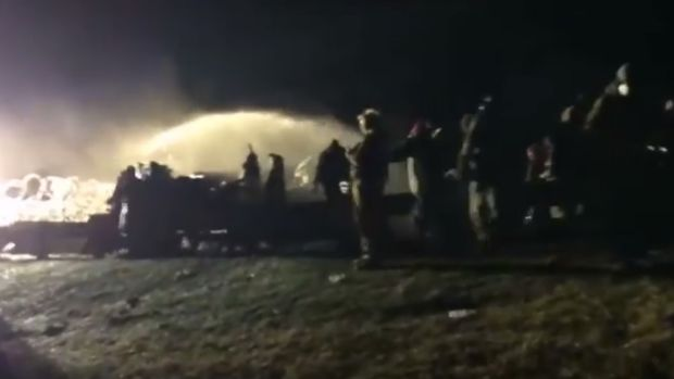 Police Spray Water On DAPL Protesters In Freezing Temps (Video) Promo Image