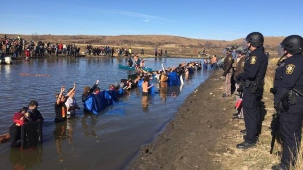 2,000 Veterans To Stand With Dakota Pipeline Protesters Promo Image