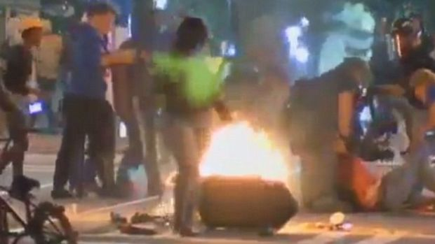 Rioters Beat Man, Almost Push Reporter In Fire (Video) Promo Image