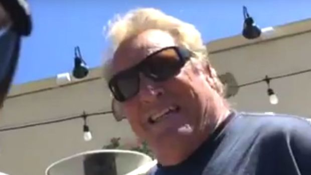 Angry Driver Threatens To 'Pull Trump' On Cyclist (Video) Promo Image