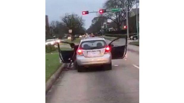 Woman Stops Traffic To Beat Passenger (Video) Promo Image
