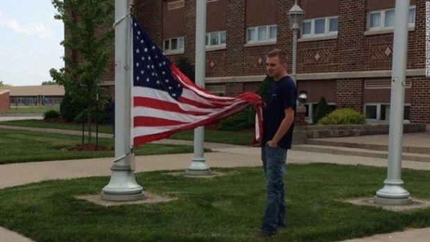 Teen's Patriotic Act Earns Praise Promo Image