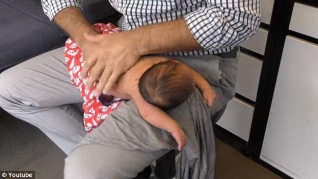 Chiropractor Cracks Baby's Spine (Video) Promo Image