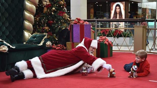 Mall Santa Plays With Autistic Boy