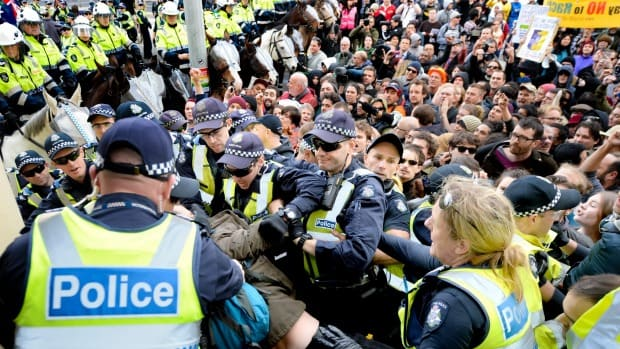 Police maintain order as hardline United Patriots Front protesters clash with anti-racist protesters on the steps of the Richmond Town Hall in May