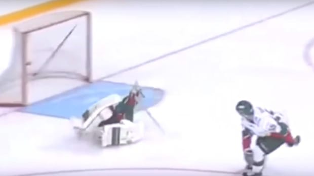 Hockey Player Throws His Stick To Score Goal (Video) Promo Image