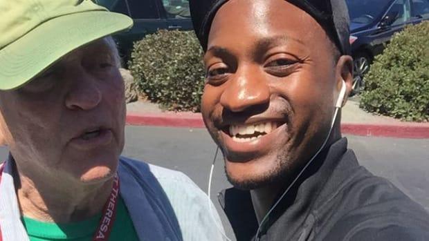 Elderly White Man Pays For Black Stranger's Groceries Promo Image