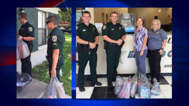 Officers Buy Groceries, Car Seat For Family (Video) Promo Image