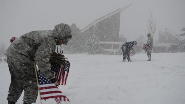 Veteran Kneels With Flag In Front Of Trump's Motorcade Promo Image
