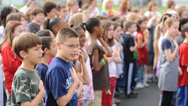 Two Young Boys Face Bullies For Standing During Pledge Promo Image