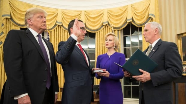Mnuchin And Wife Mocked For Posing With Sheet Of Money (Photos) Promo Image