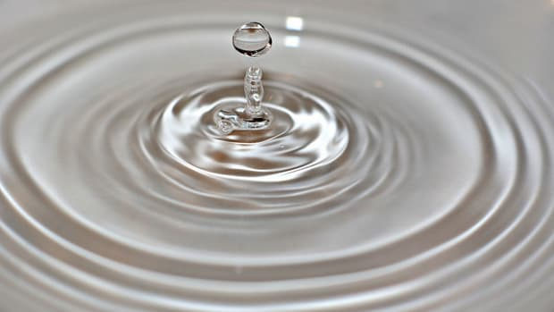 Water droplet falling from faucet