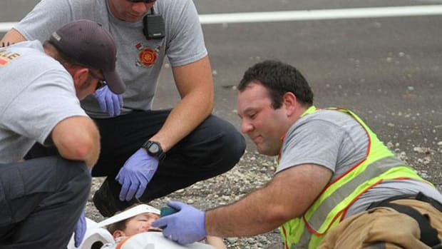Firefighter Comforts Young Car Crash Victim With 'Happy Feet'