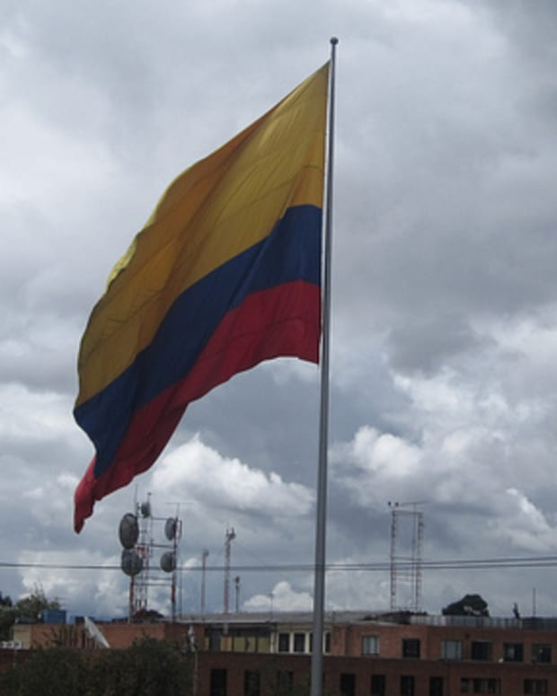 Columbian flag next to cannon