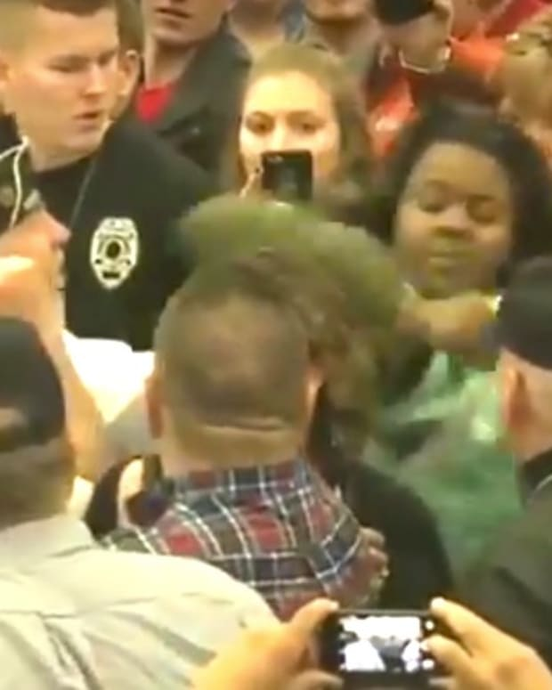 Black Woman Is Roughed Up At Trump Rally (Video) Promo Image