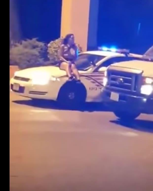 womanpolicecar.jpg