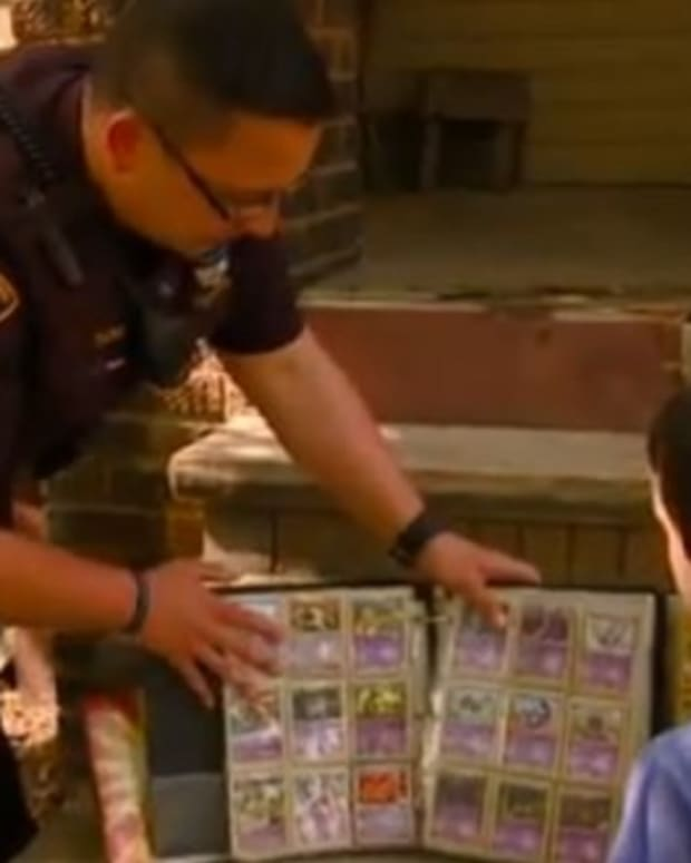 Officer Gives Boy His Pokemon Card Collection (Video) Promo Image