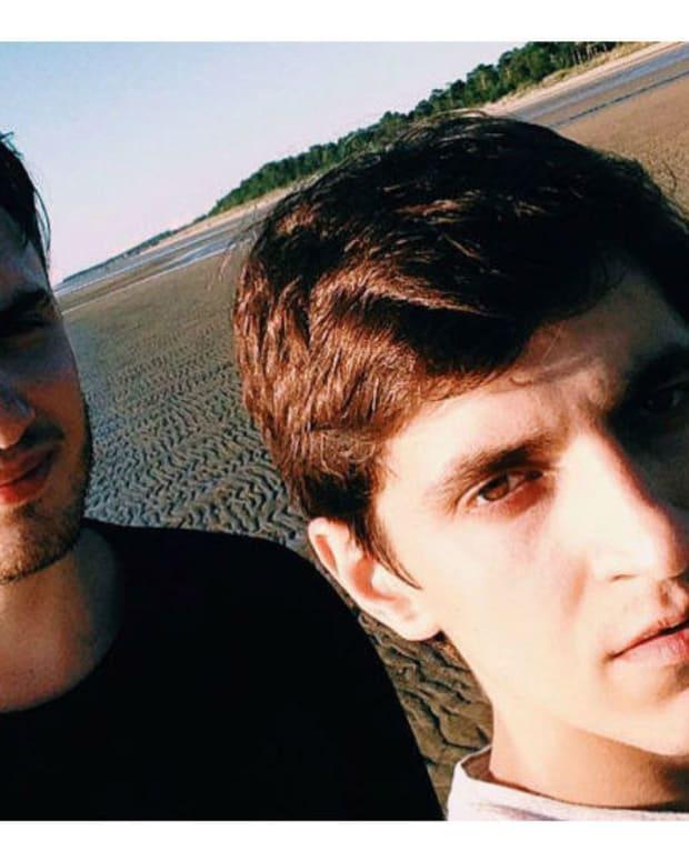 Russian Cops Arrest Gay Couple For Orlando Sympathy Note Promo Image