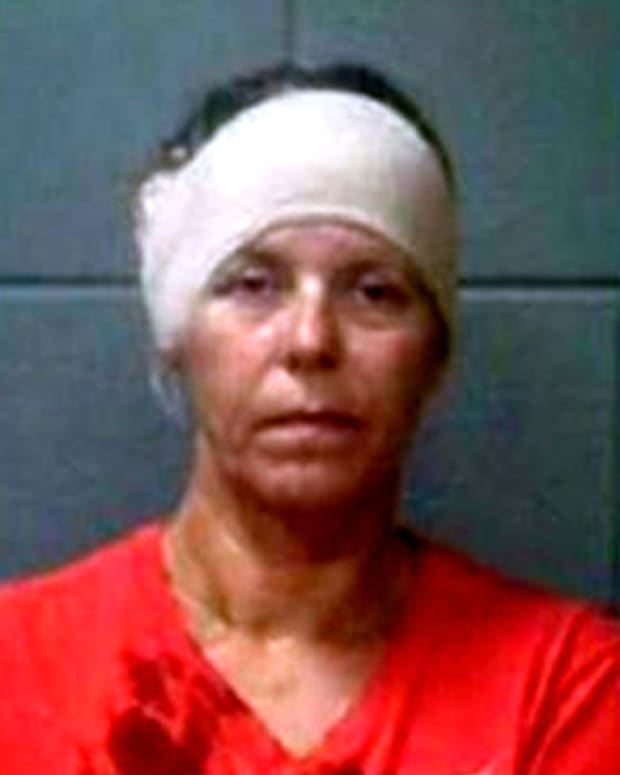 mugshot of Martinne Delavega with bandage on head