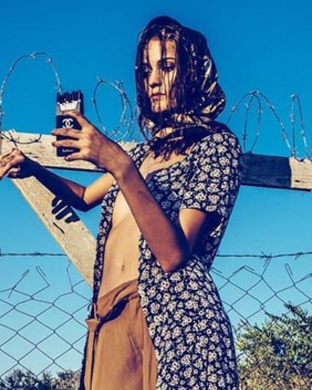 model posing as migrant
