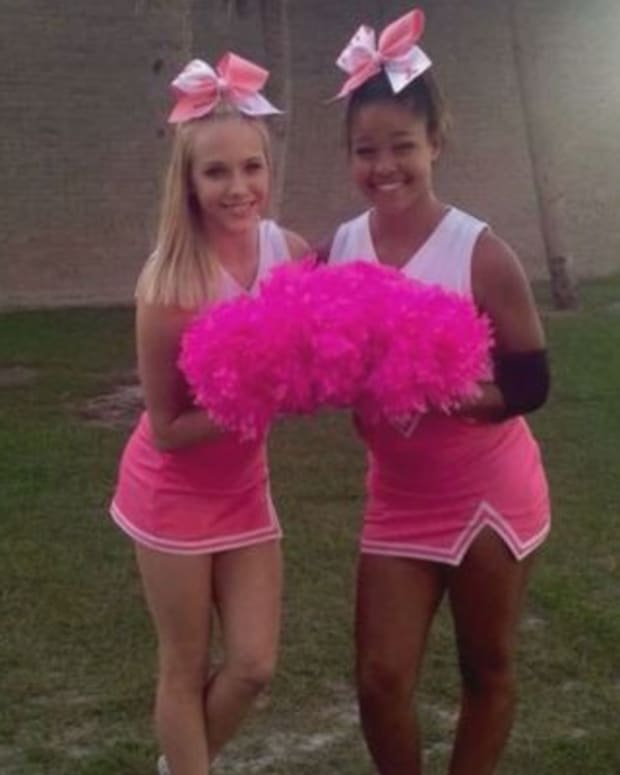 Tampa Bay Tech cheerleaders in pink uniforms
