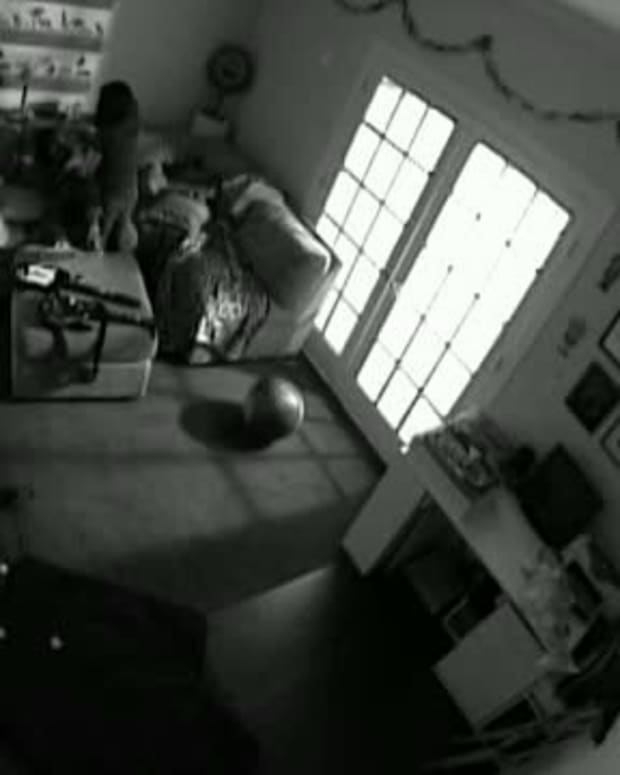 Woman Checks Secret Camera She Set Up In 6-Year-Old's Room, Immediately Calls 911 (Photo) Promo Image