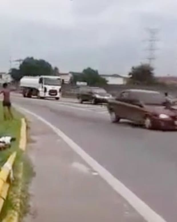Boy Hit By Car After 'Playing Chicken' In The Road (Video) Promo Image