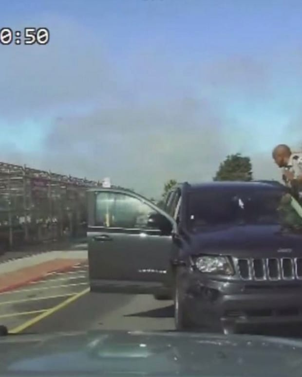 Police Chase Starts With Officers On Car (Video) Promo Image
