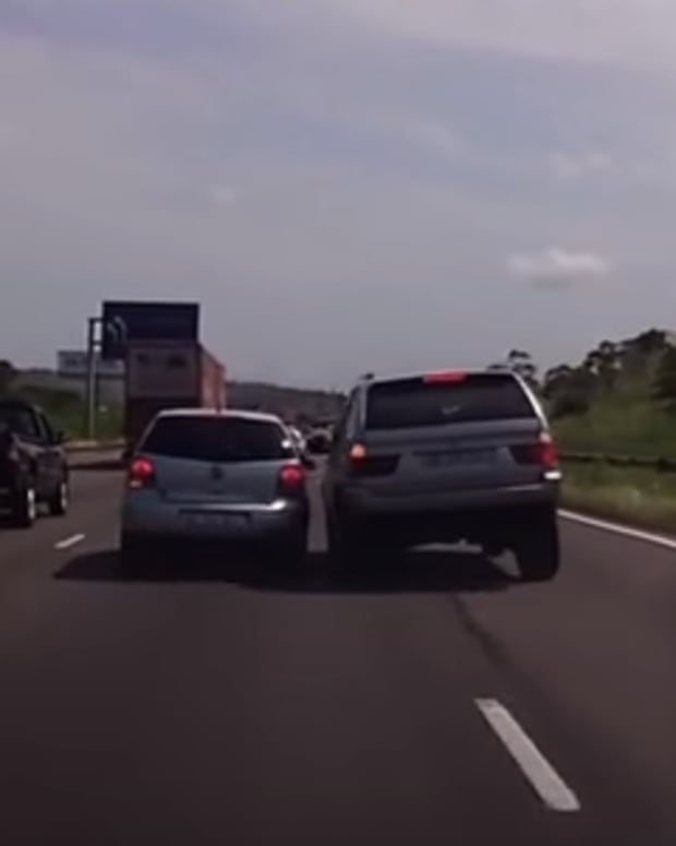 a driver with road rage nearly crashes into another car