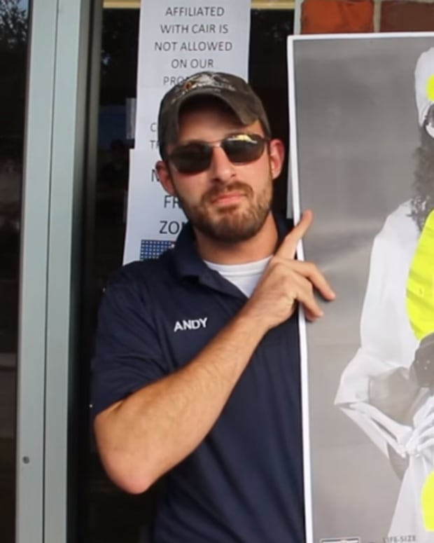 "Andy Hallinan holding up ""jihadist target practices"""