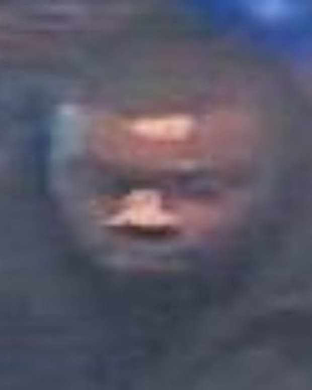 Blurry still of the robber sought by Detroit police, described as a male in his 30s with a medium build