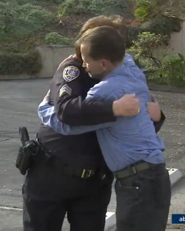 Stephen McQueen Hugs Sgt. Debbie Foy