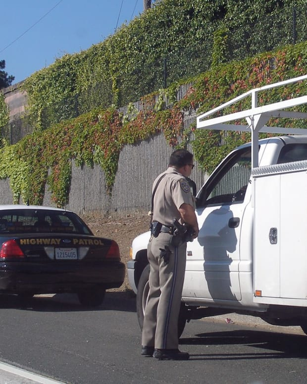 A traffic stop by a California Highway Patrol officer.